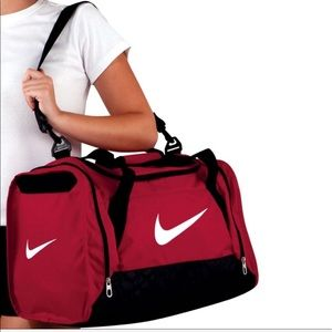 Women s Nike Brasilia Duffel Bag on Poshmark 6324d24e3d